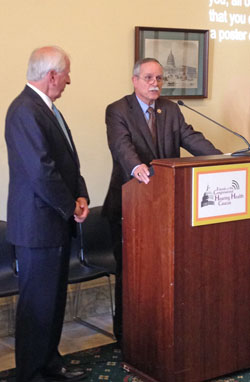 CHHC co-chairs Reps. McKinley (at podium) and Thompson (on the left) address guests at the hearing screening event.
