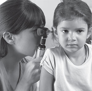 Girl having ear exam