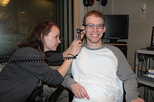 Researcher examines a patient's ear