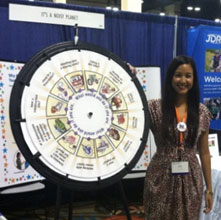 Phalla Keng and the Noisy Planet wheel at the NASN conference.