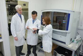 NIDCD Scientific Director Andrew Griffith, M.D., Ph.D.; Wade Chien, M.D.; and Lisa Cunningham, Ph.D., discuss use of next-generation sequencing in the NIDCD Clinical Genomics Core Facility.