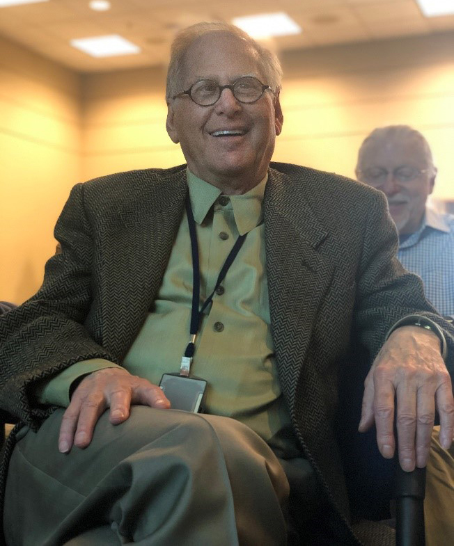 Richard Chadwick smiles as he listens to talks from mentees and collaborators at his April 10, 2019, retirement symposium.