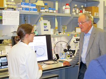 Sen. Harkin (right) speaks with Dr. Kindt during his visit to her lab.