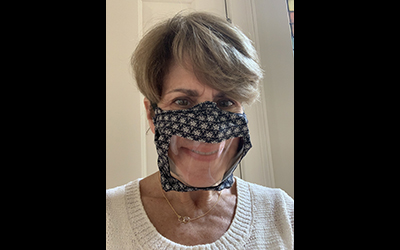 NIDCD Director Debara Tucci wearing a clear face mask.