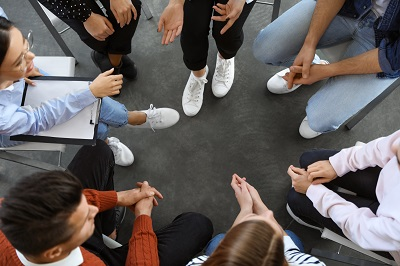 Overhead view of a group of people having a discussion.