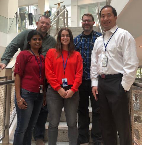 Lab staff as of October 2018. Front row L-R: Soumya Korrapati, Ph.D.,  Madeline Pyle, B.A., Michael Hoa, M.D. Back row L-R: Rafal T. Olszewski, Ph.D., Ian Taukulis, B.S.