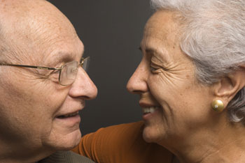 Elderly couple looking at each other
