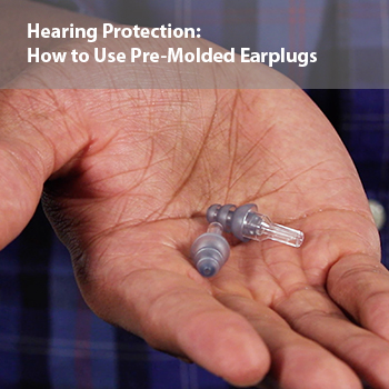 A man demonstrating the correct way to use pre-molded earplugs to help prevent noise-induced hearing loss.