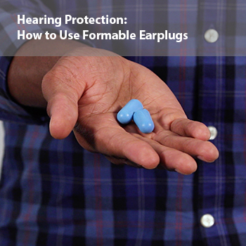 A man demonstrating the correct way to use formable earplugs to help prevent noise-induced hearing loss.